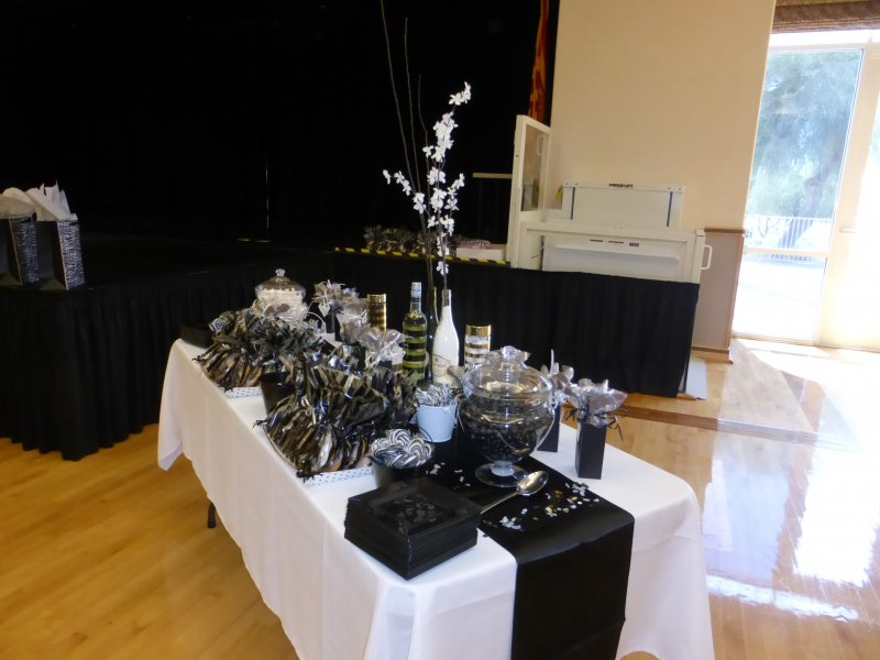 Black and White cookies,candy sticks, and wine,  SCW Lady Putters M&M's and black peanut M&M's and chocolate putter lollipops filled the dessert table.